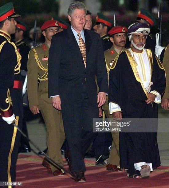 US President Bill Clinton walks with Sultan Qaboos bin Said al Said in an official ceremony at Muscat Airport in Muscat Oman 25 March 2000 Clinton is...