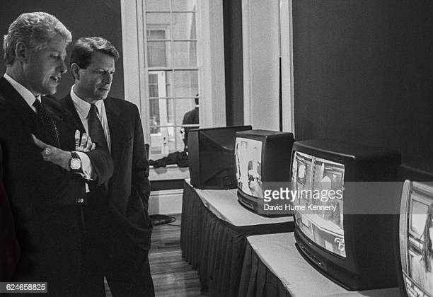 President Bill Clinton watch election returns along with Vice President Al Gore during election night in Little Rock Arkansas November 5 1996