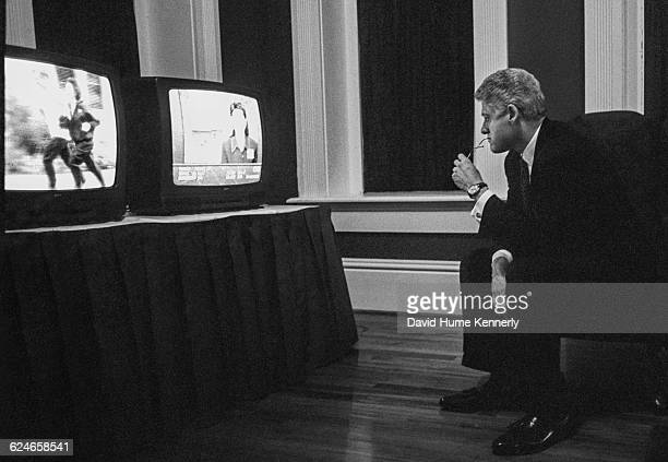 President Bill Clinton watches returns along during election night at the Old State House in Little Rock Arkansas November 5 1996 during his second...