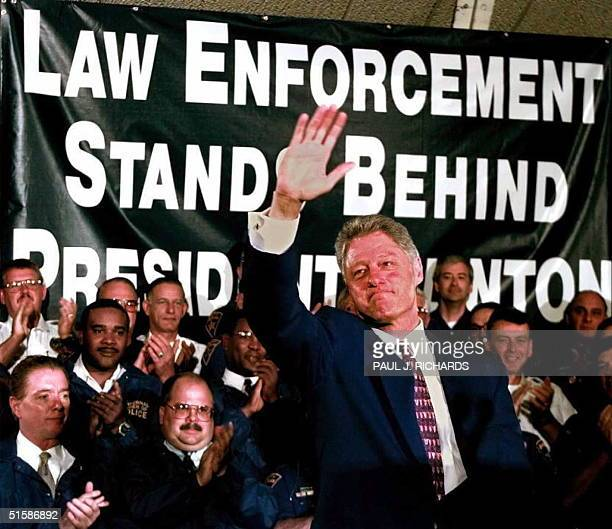 President Bill Clinton waves to the crowd as members of the Fraternal Order of Police applaud prior to Clinton 's address on crime issues to the...