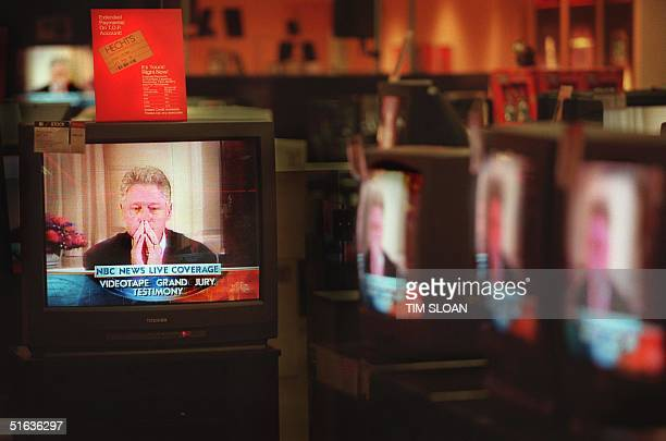 President Bill Clinton's 17 August testimony to independent counsel Kenneth Starr's grand jury is played live on multiple TV's at a Hechts Store in...
