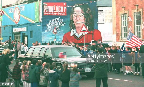 President Bill Clinton's car passes the Sinn Fein headquarters in Falls Road in Belfast with a mural of hungerstriker Bobby Sands in the background...