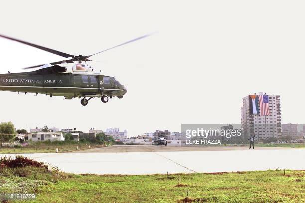 President Bill Clinton's helicopter lands 14 December in Gaza City to meet with Palestinian leader Yasser Arafat in Arafat's office . Earlier 14...
