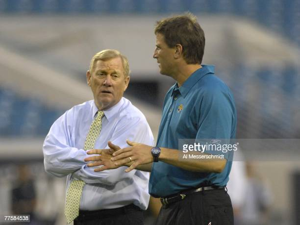 President Bill Polian of the Indianapolis Colts talks with quarterbacks coach Mike Shula of the Jacksonville Jaguars at the Jacksonville Municipal...