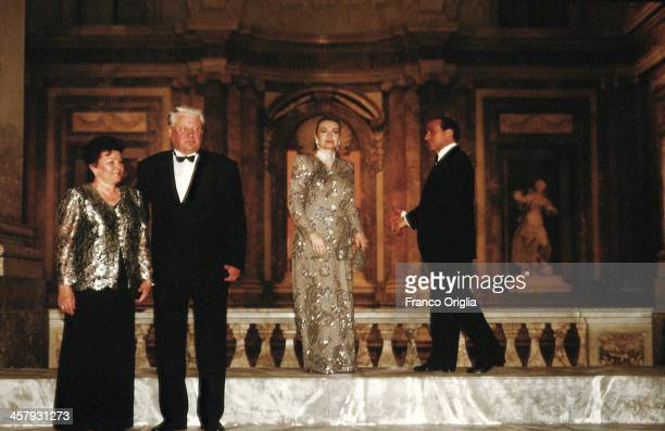 President Boris Yeltsin of Russia and his wife Naina Yeltsin in the background Italian Prime Minster Silvio Berlusconi and his second wife Veronica...