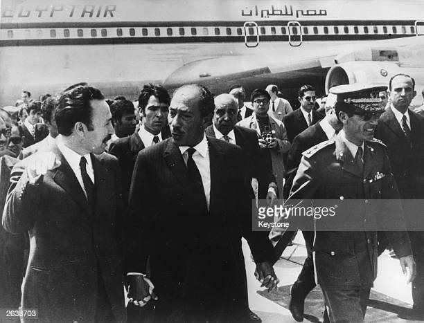 President Boumedienne of Algeria President Sadat of Egypt and Colonel Gaddafi of Libya are meeting for a mini conference on the current Near East...