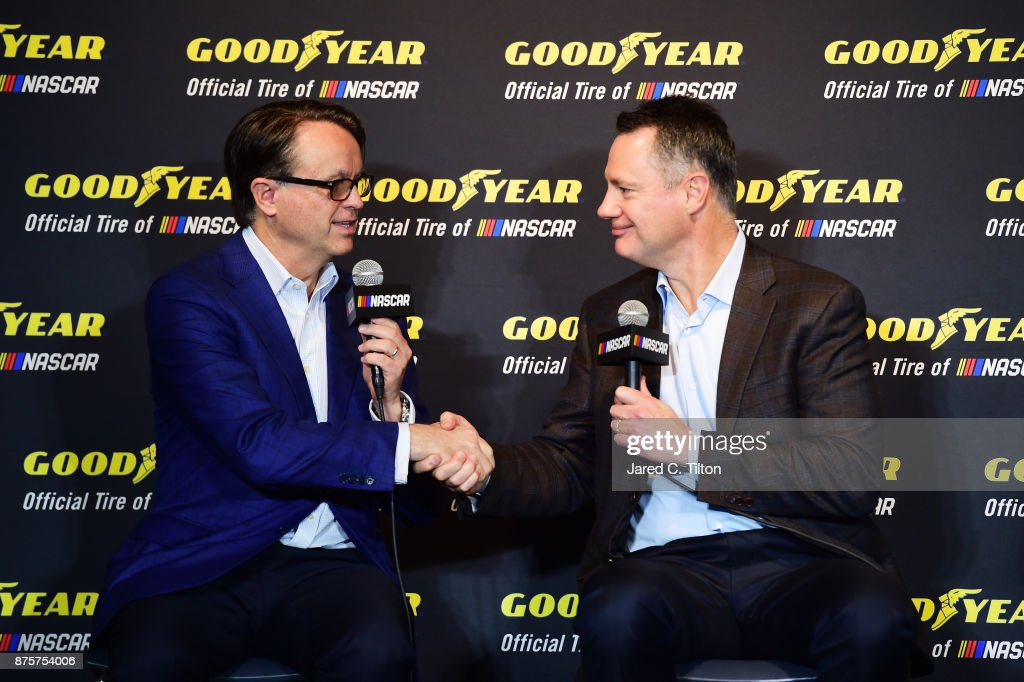 President Brent Dewar (L) and Goodyear President and CEO Rich Kramer attend a press conference announcing the renewal of the partnership between NASCAR and Goodyear at Homestead-Miami Speedway on November 18, 2017 in Homestead, Florida.