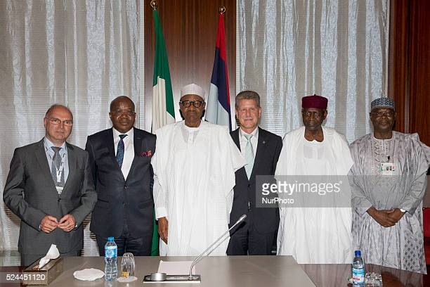 President Buhari in a group photograph with LR Managing Director Engr Detlev Lubasch Director and Leader of delegation Mr Mutiu Sunmonu President...