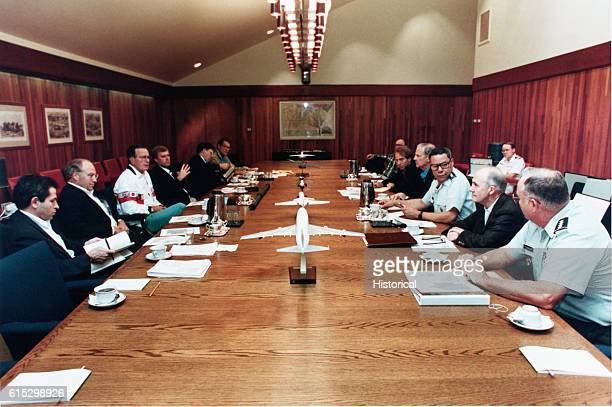 President Bush and his cabinet meet with military advisers to discuss the recent invasion of Kuwait by Iraqui forces August 4 1990