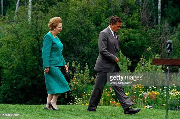 President Bush and Margaret Thatcher Walking