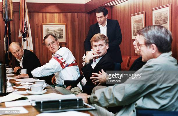 President Bush and some of his advisors discuss Iraq at Camp David. The President, Vice-President Dan Quayle, and Secretary of Defense Dick Cheney...
