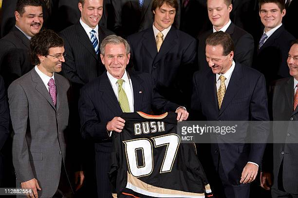 President Bush center is presented a team jersey by Anaheim Ducks' owner Henry Samueli and Scott Niedermayer during a ceremony honoring the 2007 NHL...
