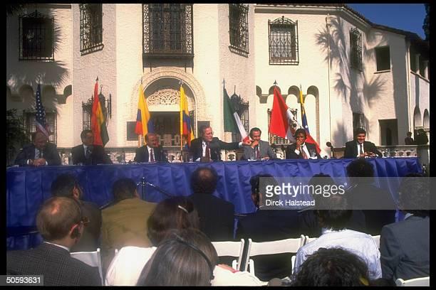 President Bush flanked by Latin leaders incl Fujimori Gortari unident Paz Zamora Gaviria holding outdoor drug summit news conf