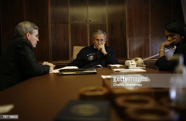 President Bush flanked by Secretary Rice and National security advisor Steve Hadley place a secure call on AF1 through to Jordan?s King Abdullah to...