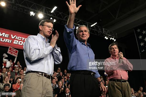 President Bush greets supporters alongside Senator Jim Talent and House Majoirty Whip Roy Blunt at a Republican party rally for Senator Talent in...
