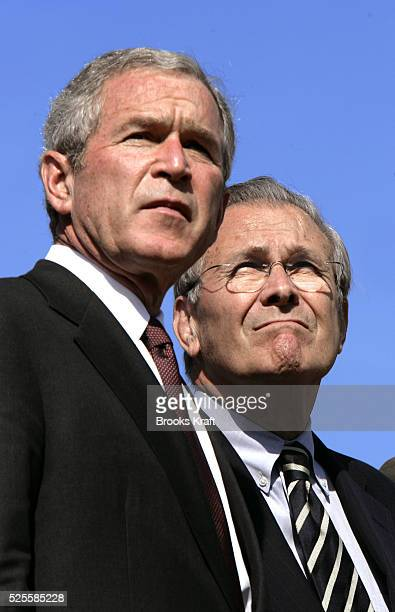 President Bush, left, and Secretary of Defense Donald Rumsfeld watch a flyover during an Armed Forces farewell tribute in honor of Chairman of the...