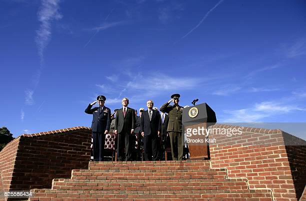 President Bush, second from left, and Secretary of Defense Donald Rumsfeld, third from left, participate in an Armed Forces farewell tribute in honor...