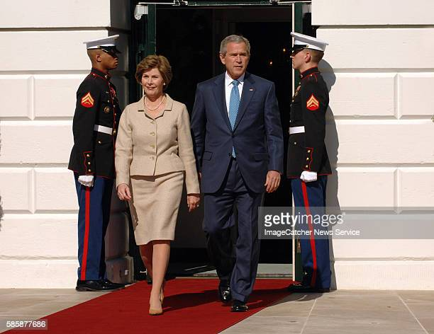 President Bush second right and the first lady Laura Bush second left prepare to greet Prince Charles and his wife Camilla the Dutchess of Cornwall...