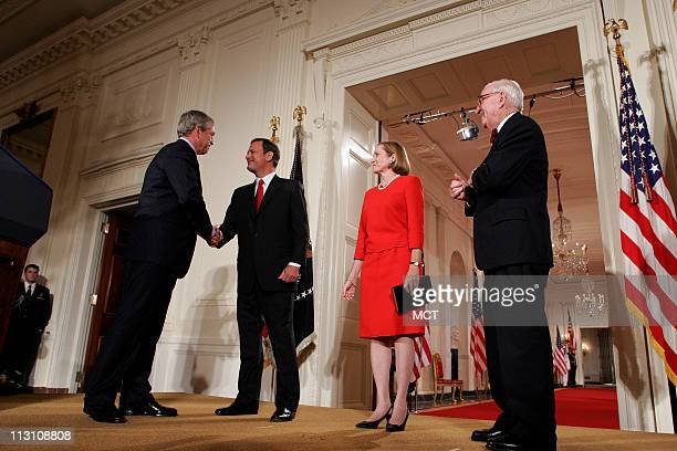 President Bush shakes Judge John Roberts hand after being sworn in by Supreme Court Justice John Paul Stevens, Thursday, Sept. 29 as the 17th Chief...