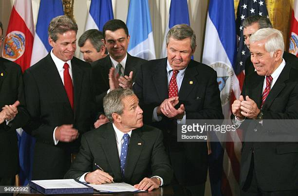 President Bush Signs The Central American Free Trade Agreement Stock