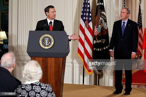President Bush watches as Judge John Roberts speaks after being sworn in by Supreme Court Justice John Paul Stevens, Thursday, Sept. 29 as the 17th...