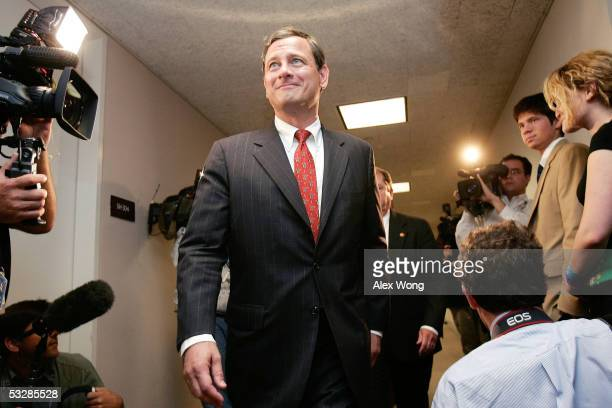 President Bush's nominee for the Supreme Court John G Roberts arrives for a meeting with US Senator Sam Brownback on Capitol Hill July 25 2005 in...