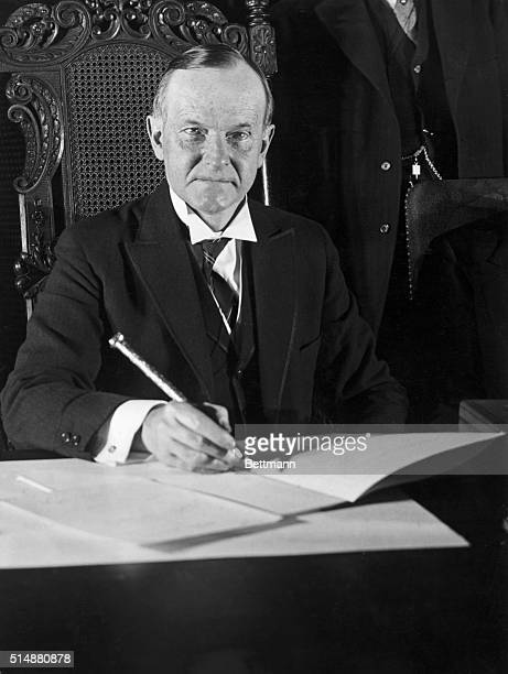 President Calvin Coolidge seated at his desk Undated