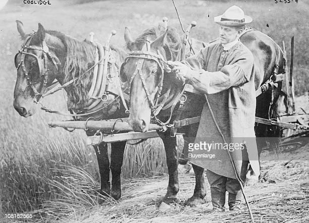 President Calvin Coolidge , shown with a team of horses, while on his farm in Plymouth Notch, Vermont, ca 1930s.