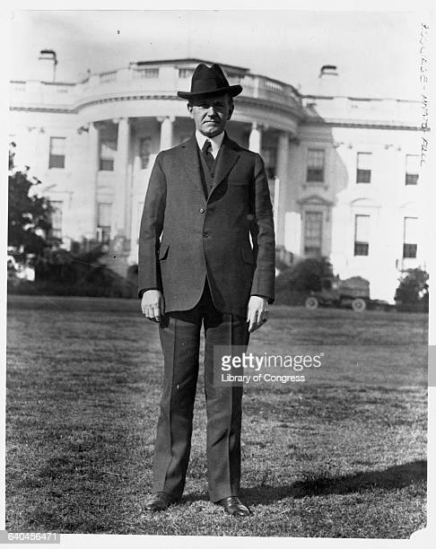 President Calvin Coolidge stands before the White House on the South Lawn