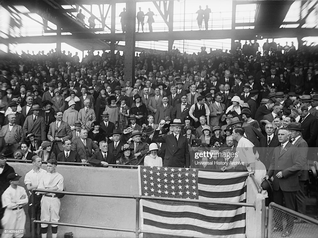U.S. President Calvin Coolidge Throwing out First Baseball at World Series Game between Washington Senators and New York Giants, Griffith Stadium, Washington DC, USA, circa 1924 : News Photo