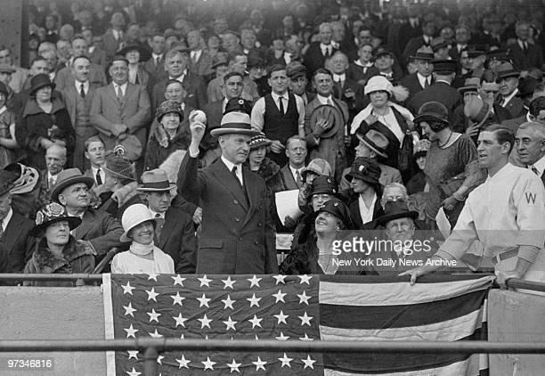 President Calvin Coolidge throws first baseball at the beginning of a Washington Senator's game From left to right Mrs Coolidge the President Mrs...