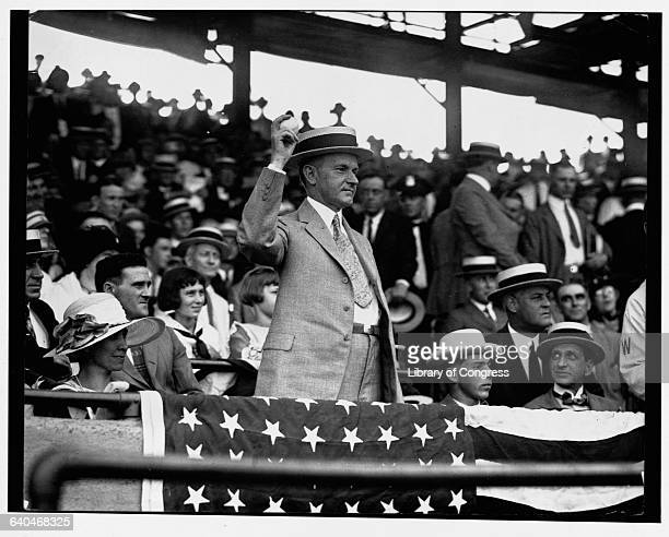 President Calvin Coolidge tosses out the ceremonial first ball in a 1925 game between the Washington Senators and the Philadelaphia Athletics