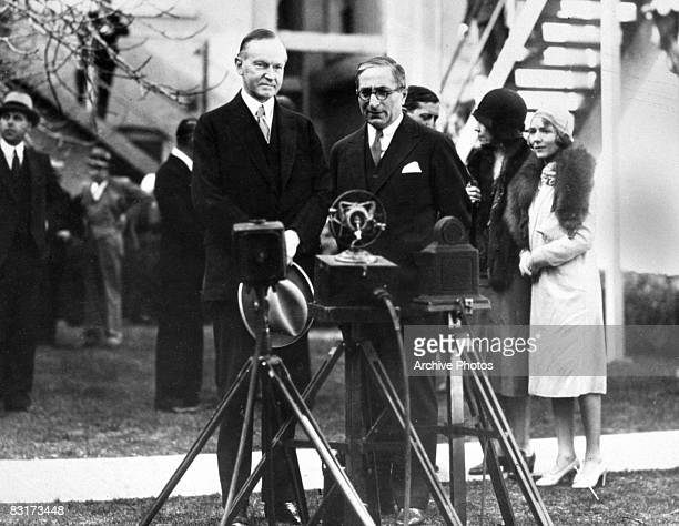 President Calvin Coolidge with Russian born film producer Louis B. Mayer on the MGM lot in Los Angeles, 19th February 1930. Actress Mary Pickford and...
