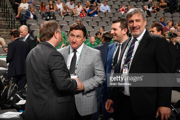 President Cam Neely and executive John Ferguson of the Boston Bruins look on from the floor during the first round of the 2018 NHL Draft at American...