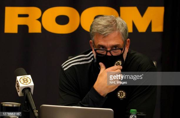 President Cam Neely of the Boston Bruins sits at his team's draft table during the first round of the 2020 NHL Entry Draft at the Warrior Ice Arena...