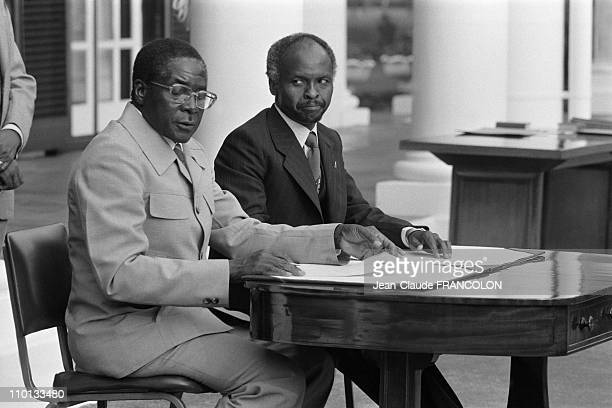 President Canaan Banana and Prime Minister Robert Mugabe attend the ceremony for the independence of Zimbabwe in Salisbury Zimbabwe on April 16 1980