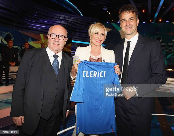 FIGC President Carlo Tavecchio Tv presenter Antonella Clerici and FIGC General Director Michele Uva pose with Italian jersey during the 'Sogno...