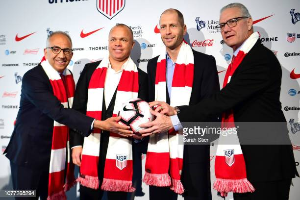 US President Carlos Cordeiro National Team General Manager Earnie Stewart Head Coach Gregg Berhalter and CEO Dan Flynn pose for a photo after a press...