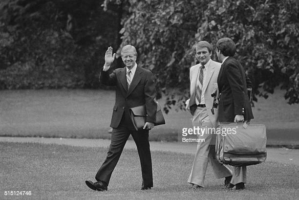 President Carter leaves the White House 5/21 to travel to Washington state where he will fly over the volcano at Mount St.Helens.At right is Press...