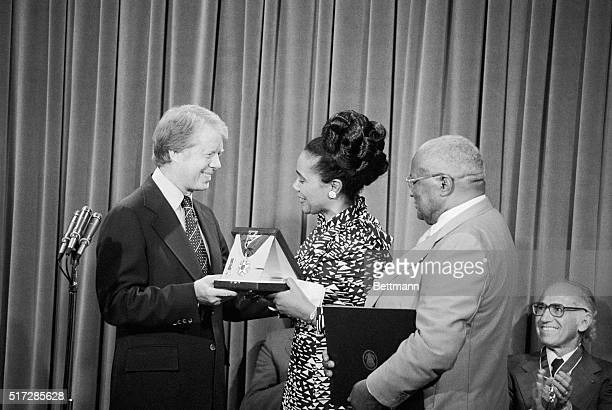 President Carter presents the Medal of Freedom here to Mrs Corretta King posthumously to her slain husband Martin Luther King Jr for his civil rights...