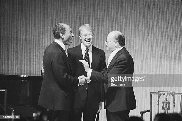 President Carter President Sadat and Prime Minister Begin share a laugh at a State Dinner honoring the Egyptian and Israeli leaders at the White...