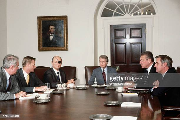 President Carter presides over a meeting between chief US and Israeli officials discussing the conditions for peace between Israel and Egypt From...