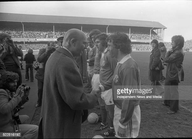 President Cearbhall Ó Dálaigh shakes John Giles' hand at the footballer's testimonial game circa 1970's