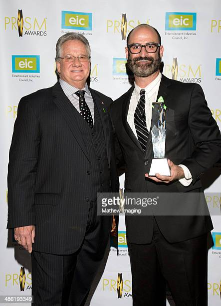 President CEO Entertainment Industries Council Brian Dyak presents the EIC President's Award to comedian Brody Stevens at the 18th Annual PRISM...
