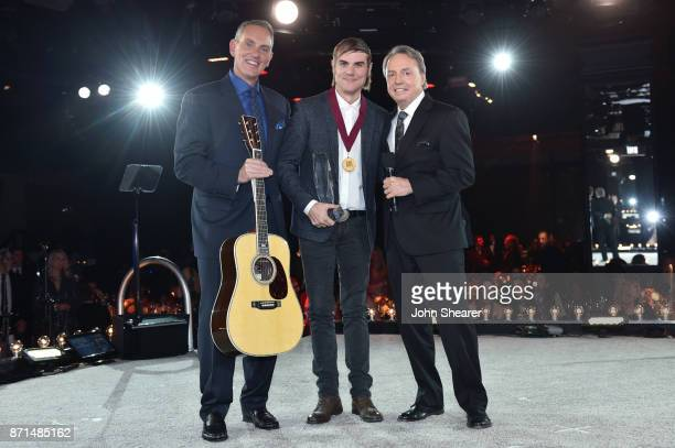 President CEO Mike O'Neill songwriter Ross Copperman BMI Vice President Creative Nashville Jody Williams pose for a photo onstage during the 65th...