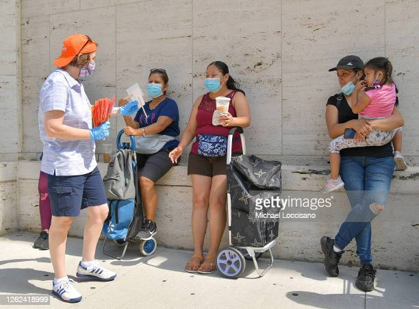 President CEO of Food Bank For New York City Leslie Gordon distributes fixed fans during Food Bank For New York City distribution event at Lincoln...