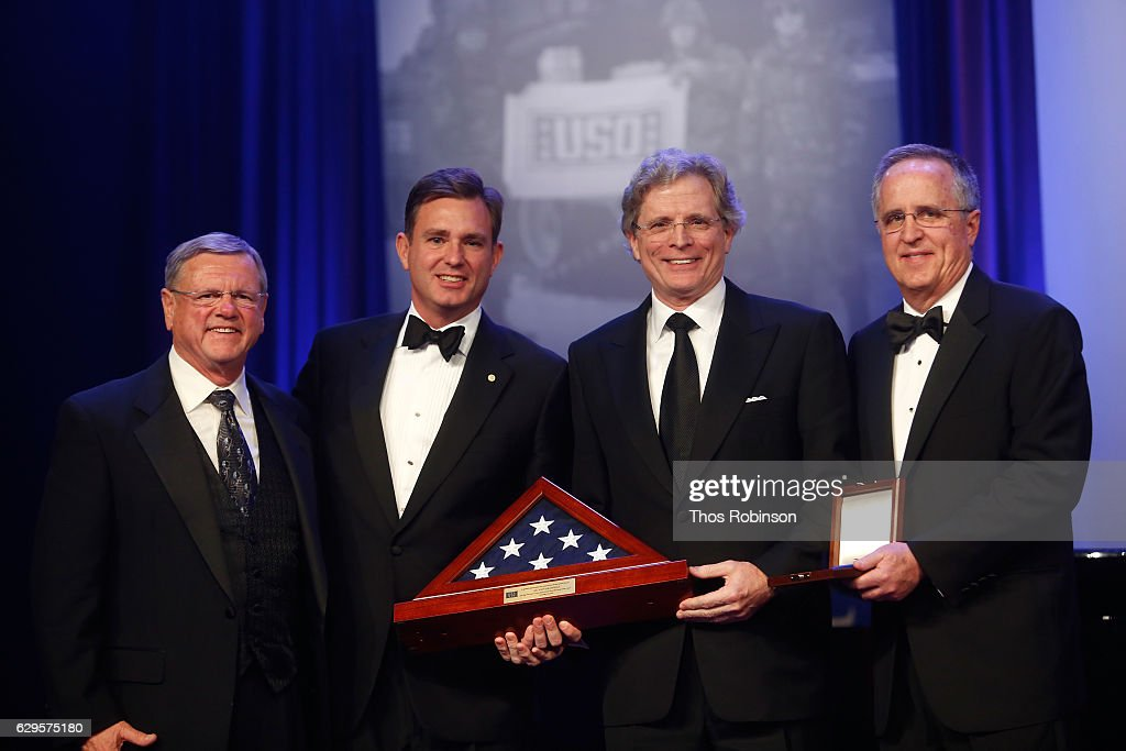 President & CEO, USO of Metropolitan New York Brian Whiting, Chairman & CEO of Prudential Financial John Strangfeld, and Chairman of the Board, USO of Metropoitan New York Chuck Hill onstage at the USO 75th Anniversary Armed Forces Gala & Gold Medal Dinner at Marriott Marquis Times Square on December 13, 2016 in New York City.