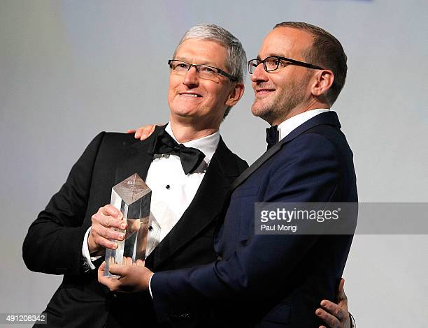 President Chad Griffin presents Apple CEO Tim Cook with the organizationÕs Visibility Award at the 19th Annual HRC National Dinner at the Walter E...
