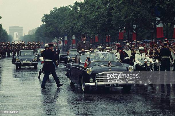 President Charles de Gaulle travels by car down the Champs Elysees on Bastille Day in 1968