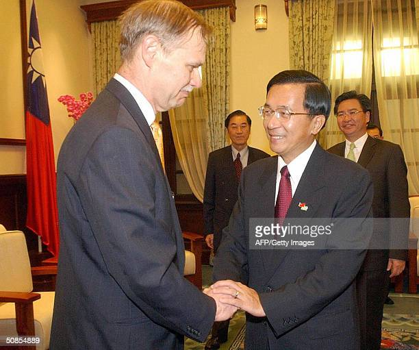President Chen Shuibian greets Richard Bush former chairman of the American Institute at the Presidential Building one day before Chen's inauguration...